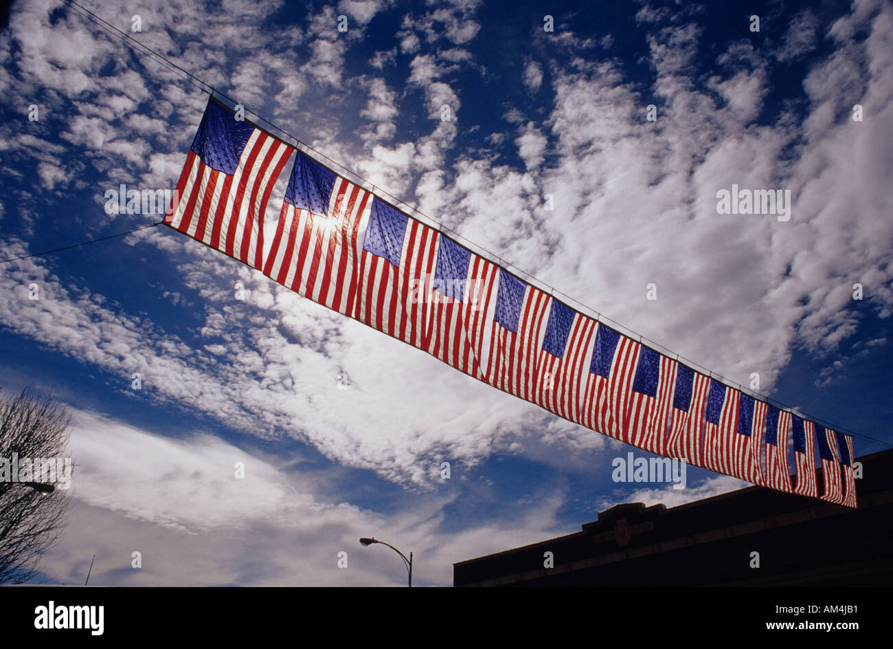 american flag banner backlit hung across main street downtown fourth