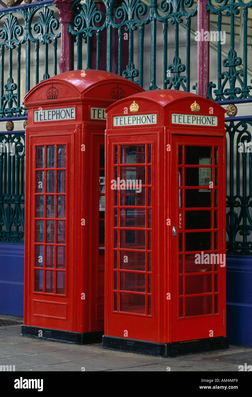 Red Telephone Boxes, Smithfield Market, London. Examples of K2 and K6 kiosks. Architect: Sir Giles Gilbert Scott - Stock Image