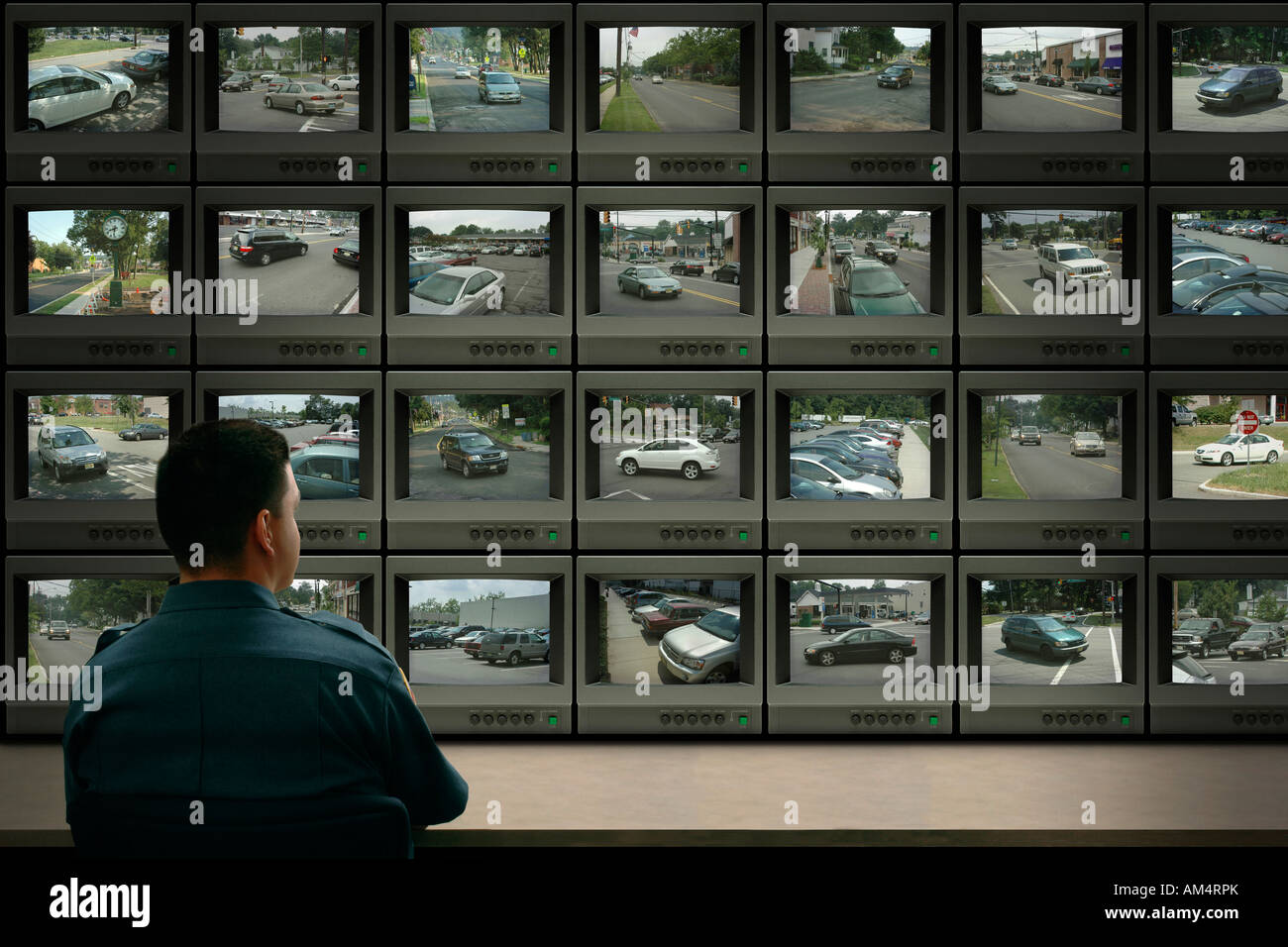 Police security surveillance with closed circuit cameras and monitors of public streets and traffic - Stock Image
