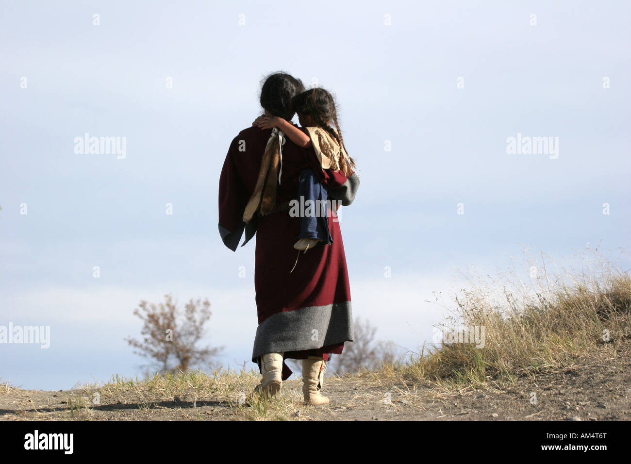 A young Native American Indian mom carrying her child - Stock Image