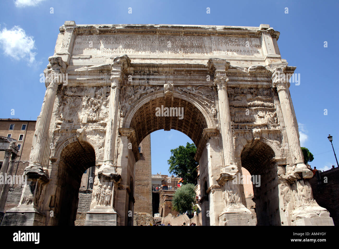 Triple arch of Septimus Severus at the Forum Rome - Stock Image