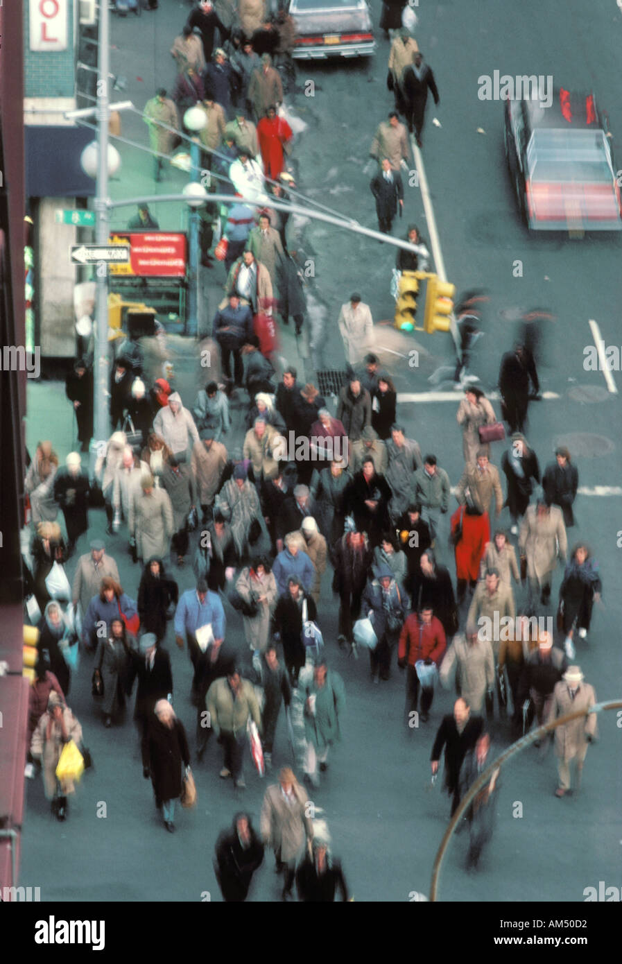 crowded city sidewalks and streets rush hour - Stock Image