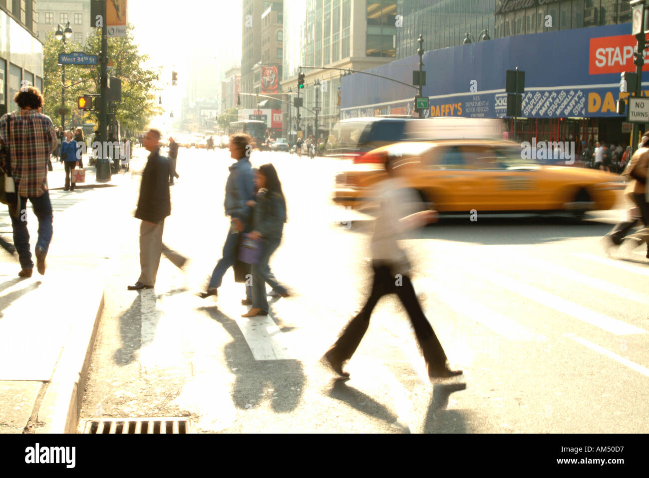 crowded New York sidewalks and streets at rush hour - Stock Image