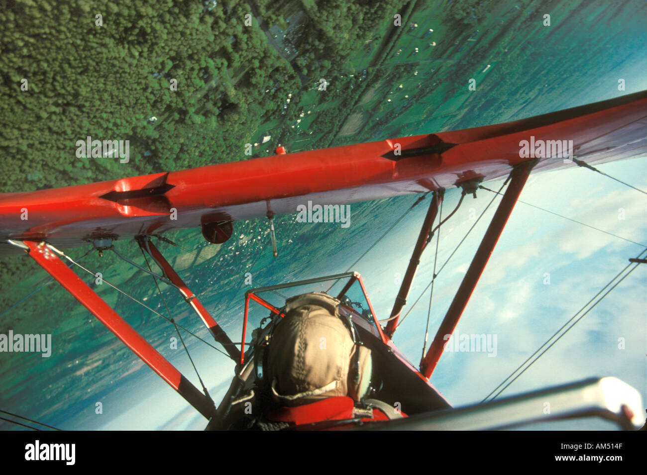 red stearman bi plane does a barrel roll - Stock Image