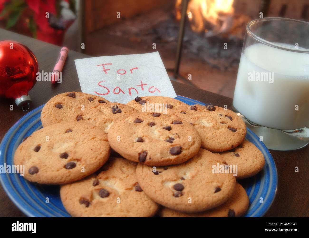 A Plate Of Chocolate Chip Cookie Left For Santa Claus Along With A