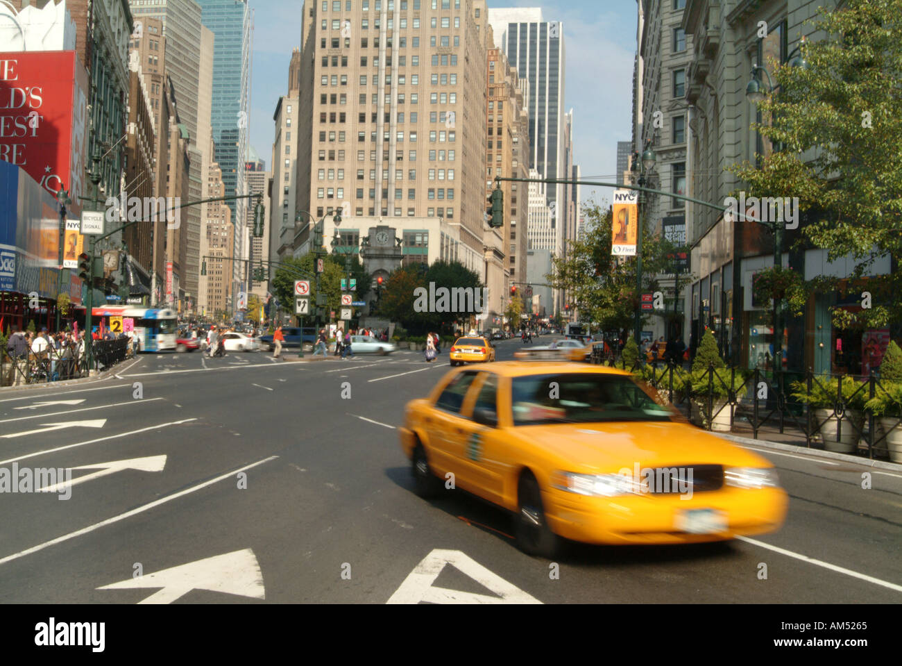 Taxi cab speeding down Broadway in Manhattan, NY - Stock Image