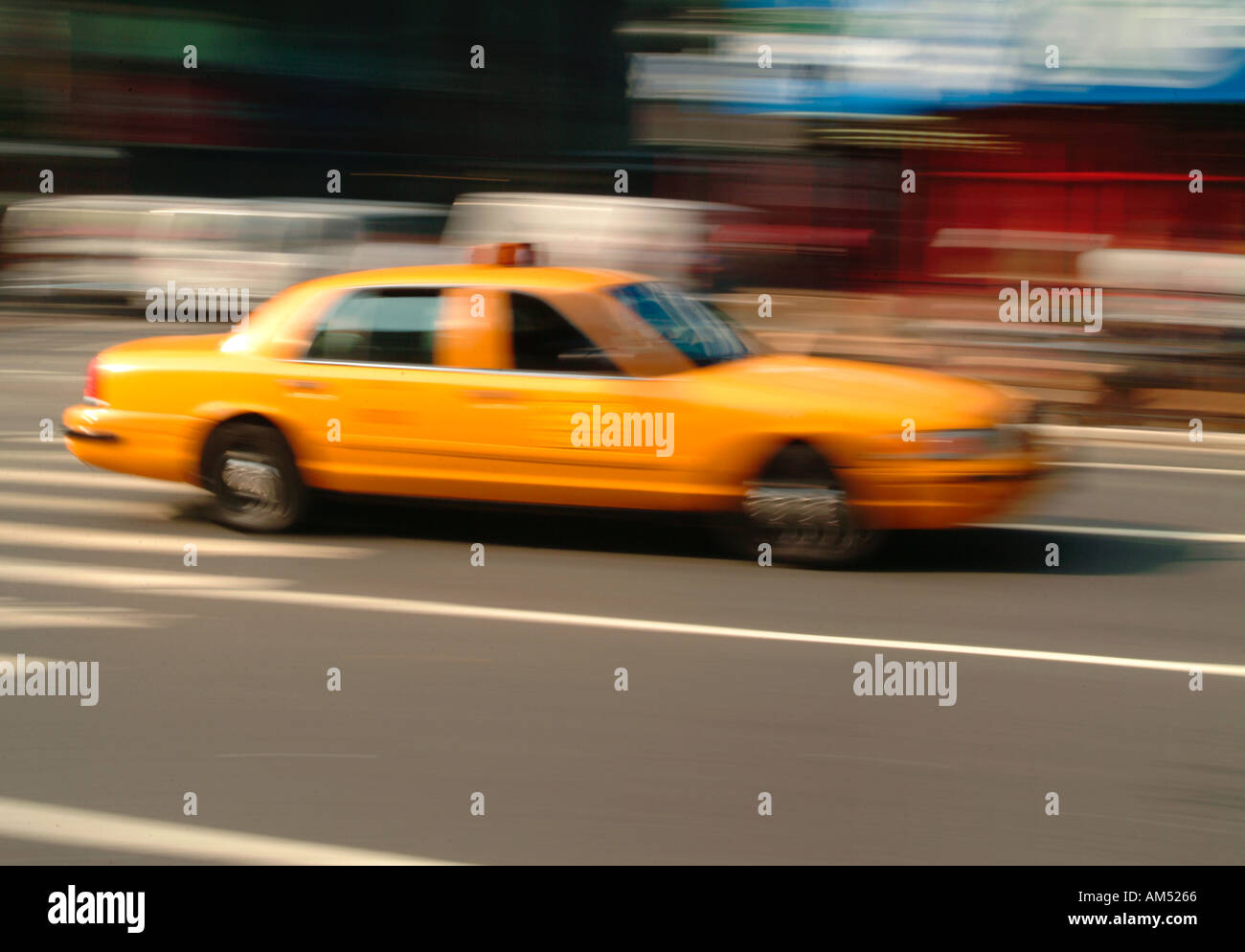 taxi cab speeding up 6th Ave in Manhattan - Stock Image