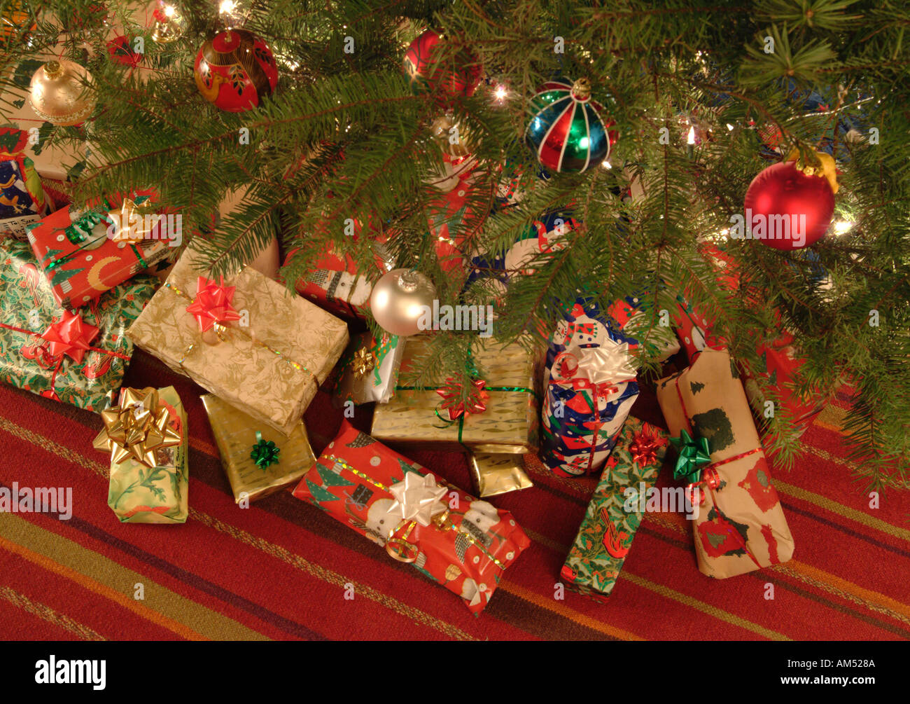 Wrapped Christmas Presents Under The Tree Stock Photo