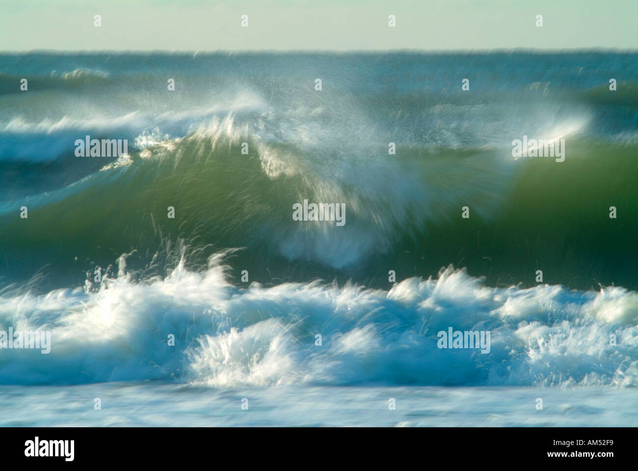 ocean surf breaking on a beach with motion blurs - Stock Image