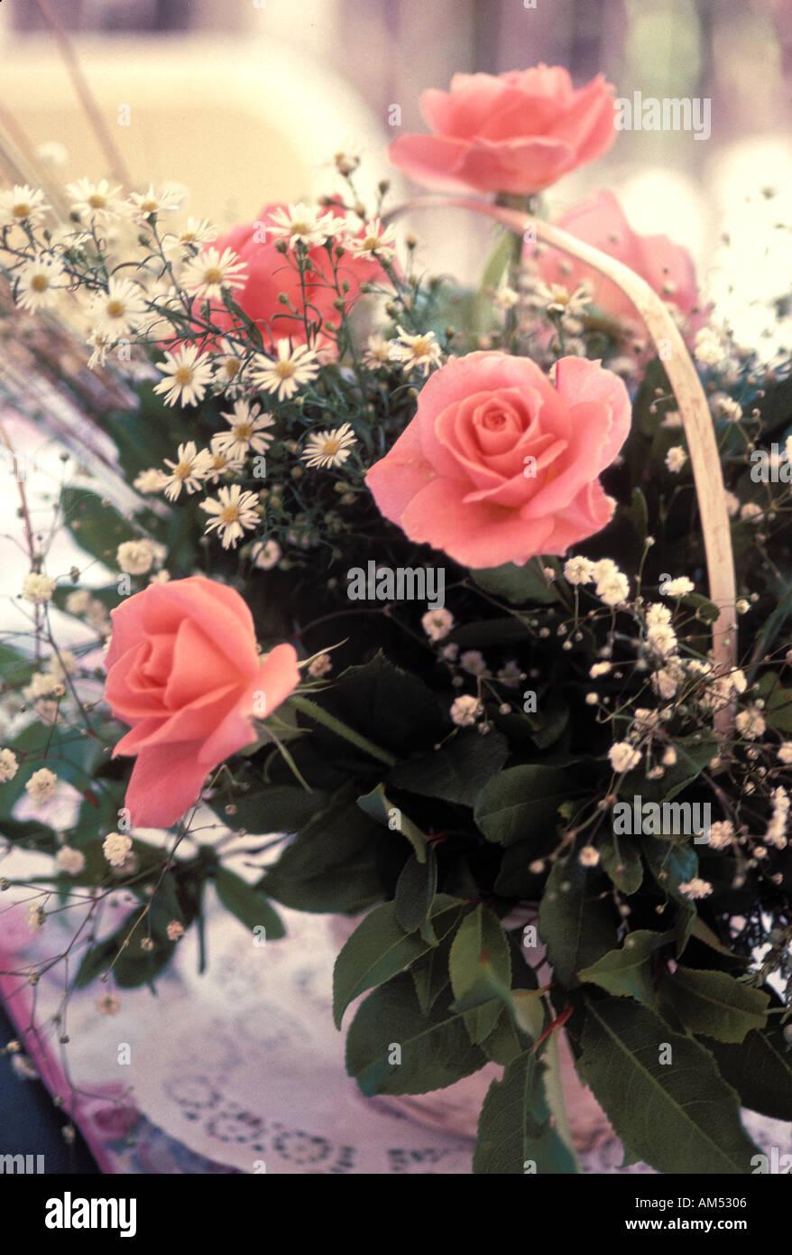Wedding flower basket of pink roses and babys breath on a reception wedding flower basket of pink roses and babys breath on a reception table mightylinksfo