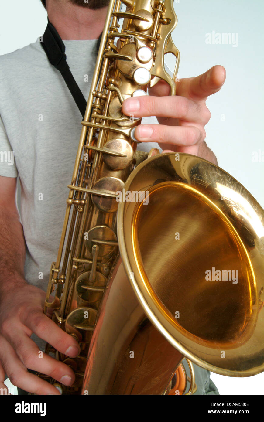 young bearded musician playing a saxophone - Stock Image