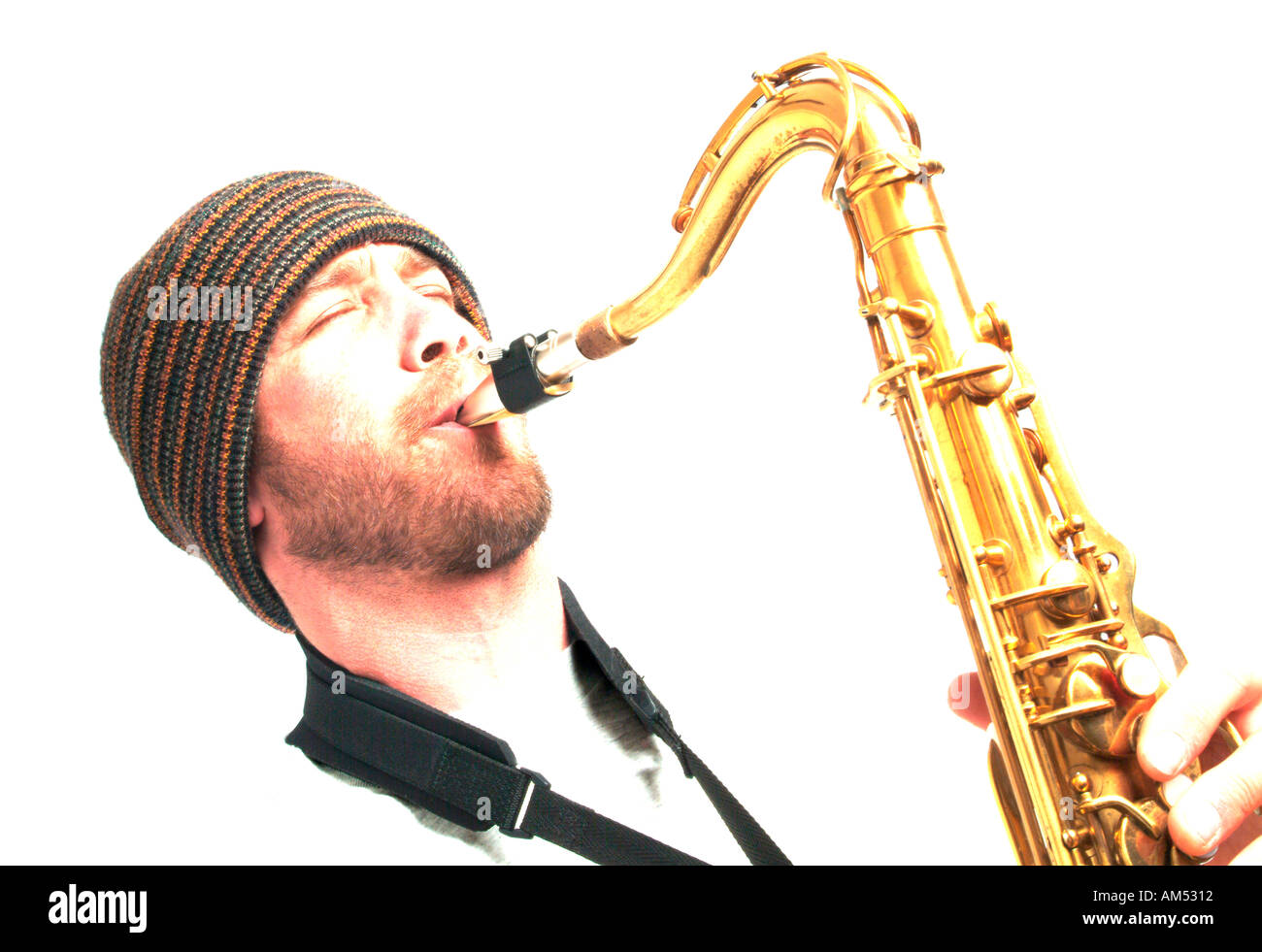 young musician playing a saxophone - Stock Image