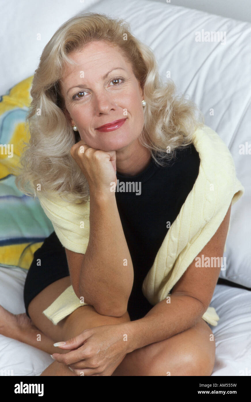 Mature woman, sitting on couch,portrait, Miami - Stock Image