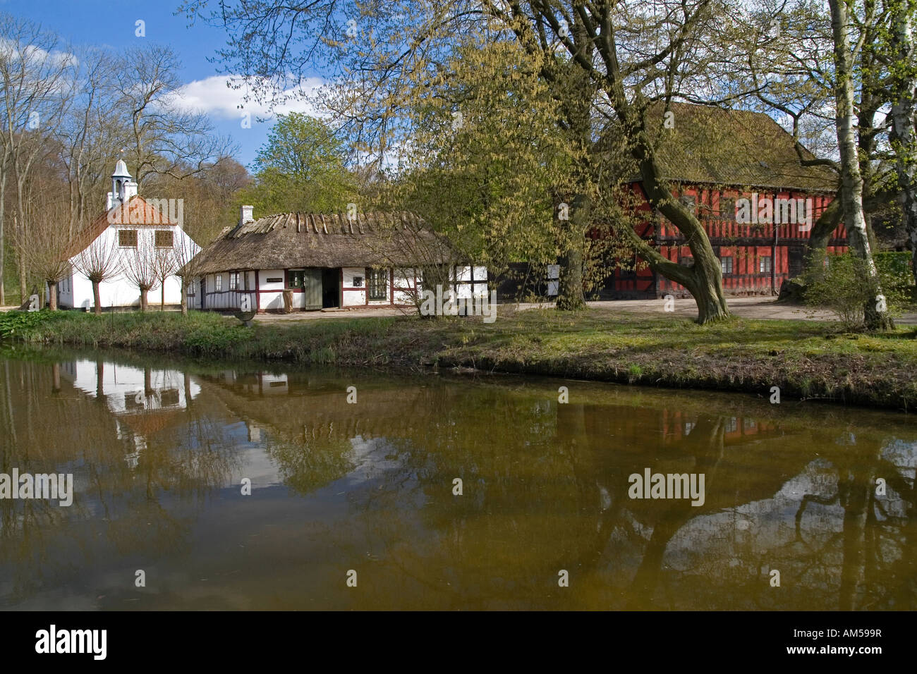 18th century Danish village with a small pond The Funen Village and open air museum Odense Denmark Stock Photo