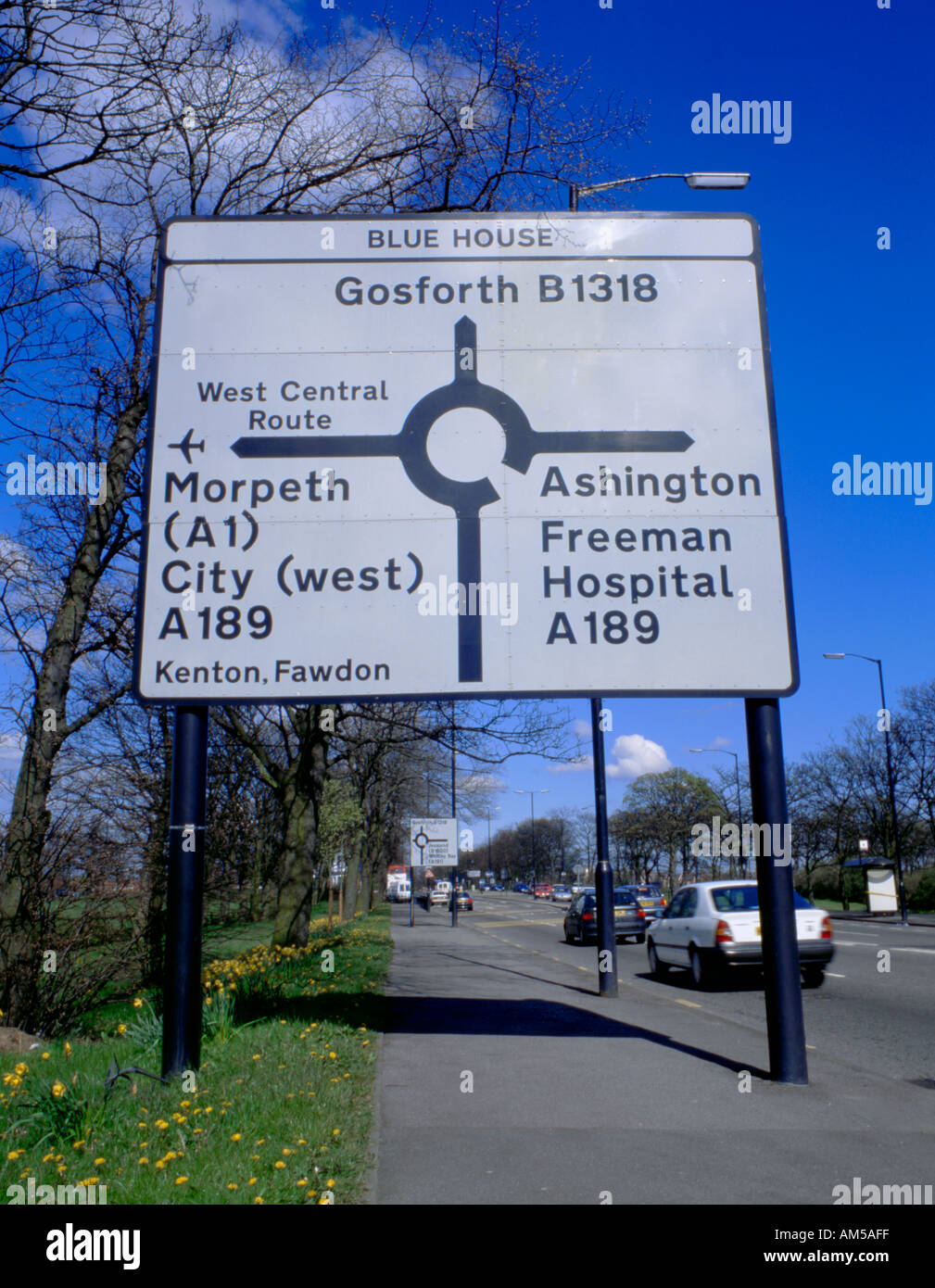 Road sign at the approach to a roundabout, Newcastle upon Tyne, Tyne and Wear, England, UK. - Stock Image
