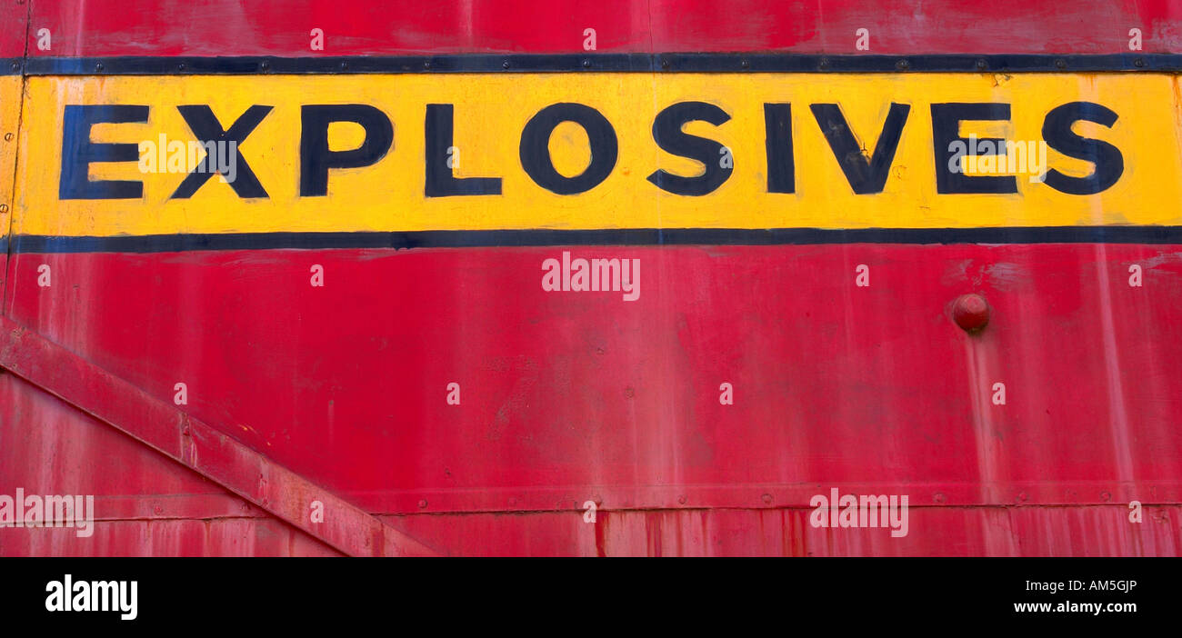 A bold Explosives Sign on the side of a train carriage. - Stock Image
