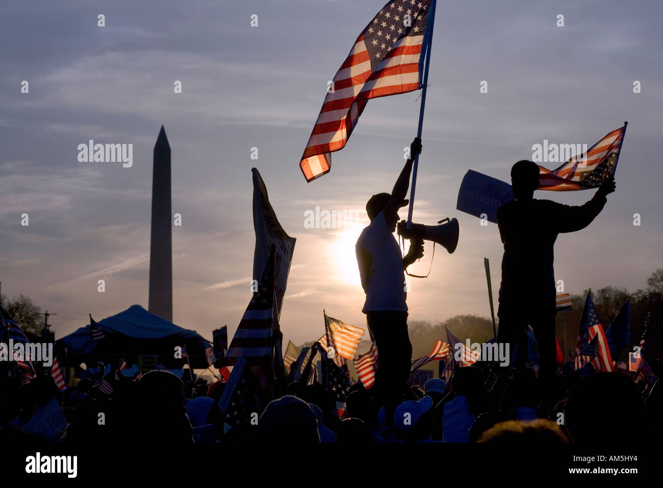 Immigrant waving flag holding a bullhorn at peaceful march of illegal immigrants in Washington DC protesting immigration Stock Photo