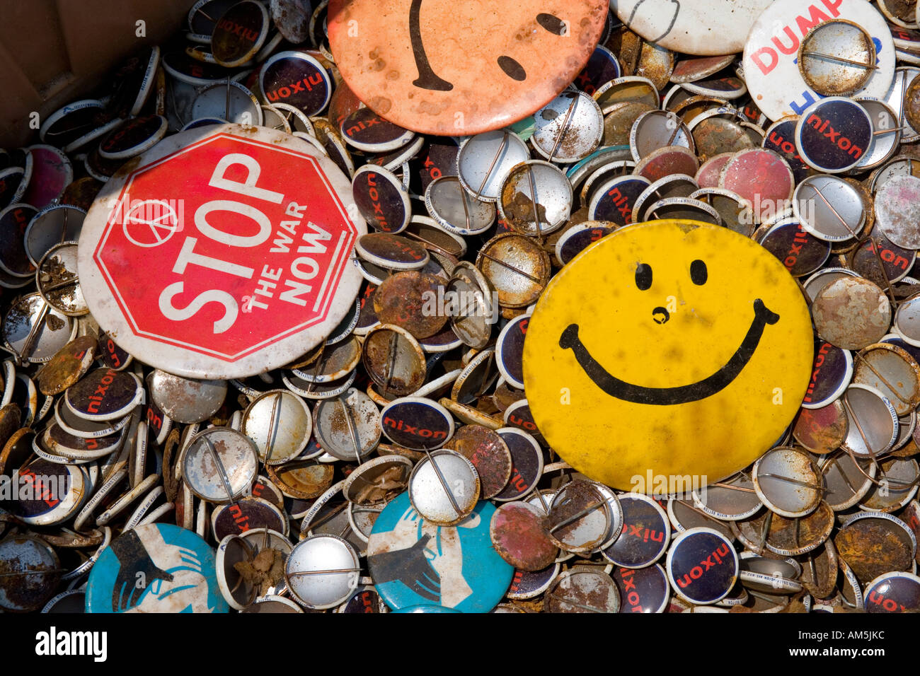 Lost hopes; lost ideals. Hundreds of rusty political and campaign buttons. Stop the war now is the most prominent slogan. - Stock Image