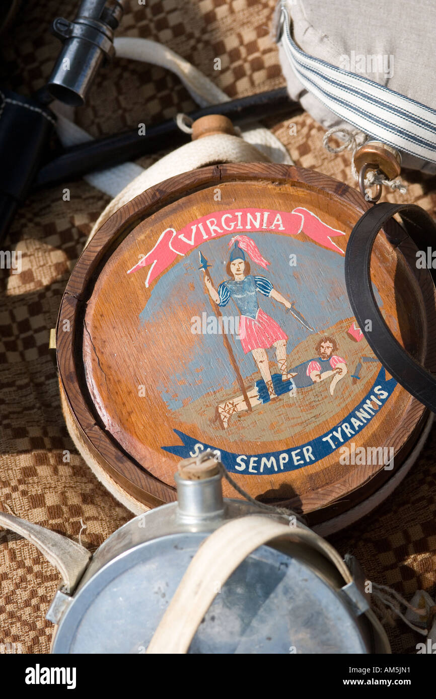 Soldier's flask from the American Civil War with Virginia State motto: Sic semper tyrannis. Display at historical re-enactment. - Stock Image