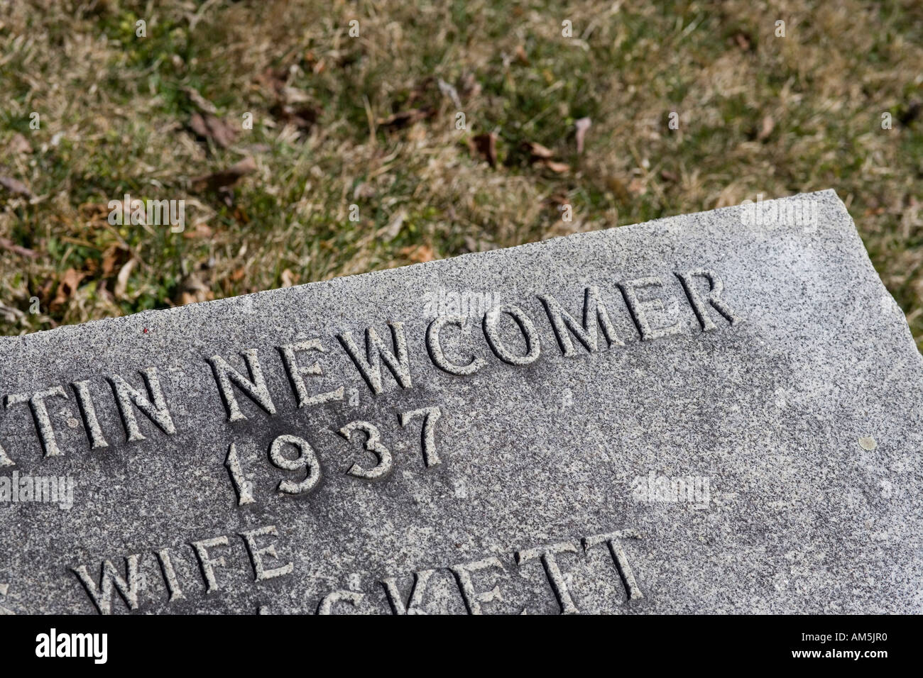 The headstone of someone of immigrant descent called Newcomer. - Stock Image
