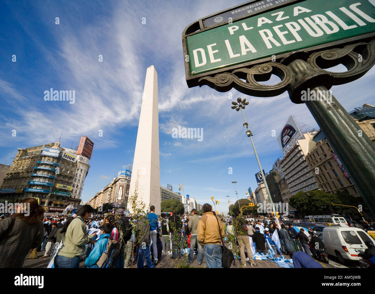 Football fans gather at the Plaza de la Republica in Buenos Aires to celebrate a victory of the national team. - Stock Image