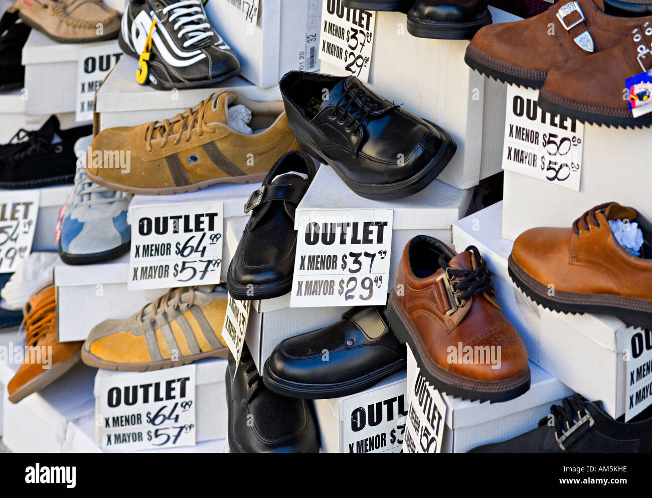 kinds of cheap shoes in a shop window