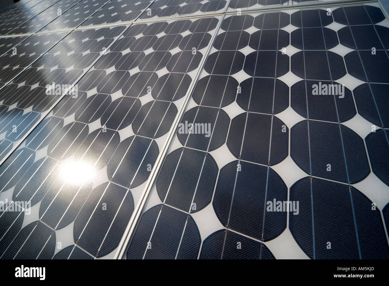 Solar panels producing electricity. Rows of monocrystalline photovoltaic solar cells. - Stock Image