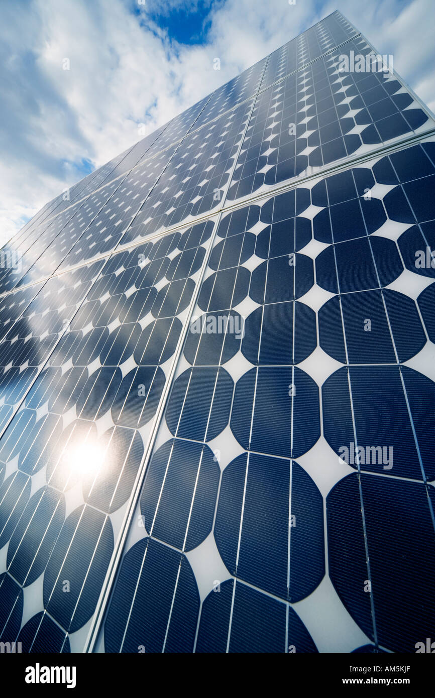 Solar panels producing electricity. Rows of monocrystalline photovoltaic solar cell panels on a roof. - Stock Image