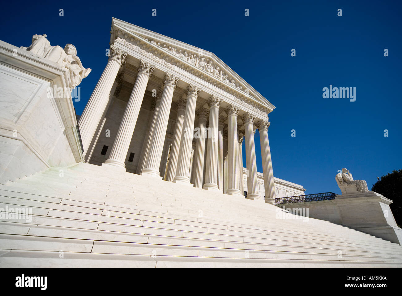 Main entrance, colonnade, steps and statues of the U.S. Supreme Court Building. Washington DC - Stock Image