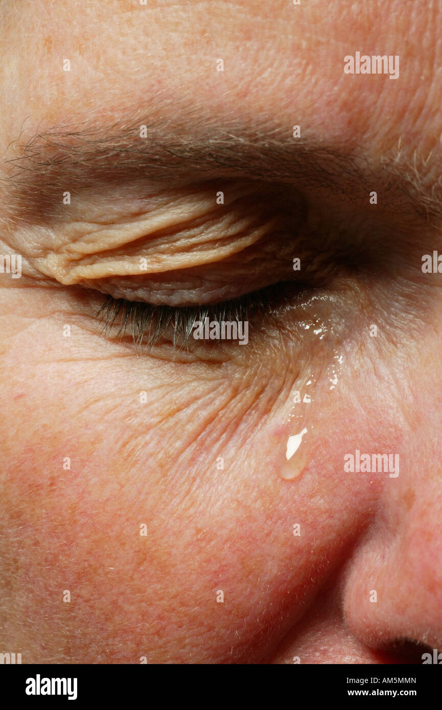 Eye with a teardrop - Stock Image