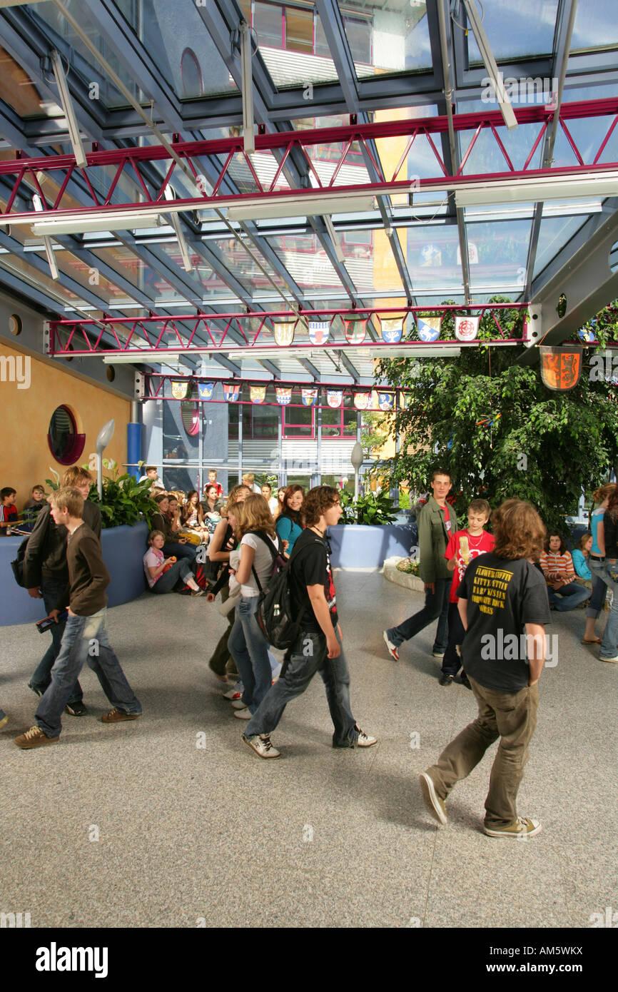 Pupils in the break hall of a modern school, Waldkraiburg, Upper Bavaria, Bavaria, Germany - Stock Image
