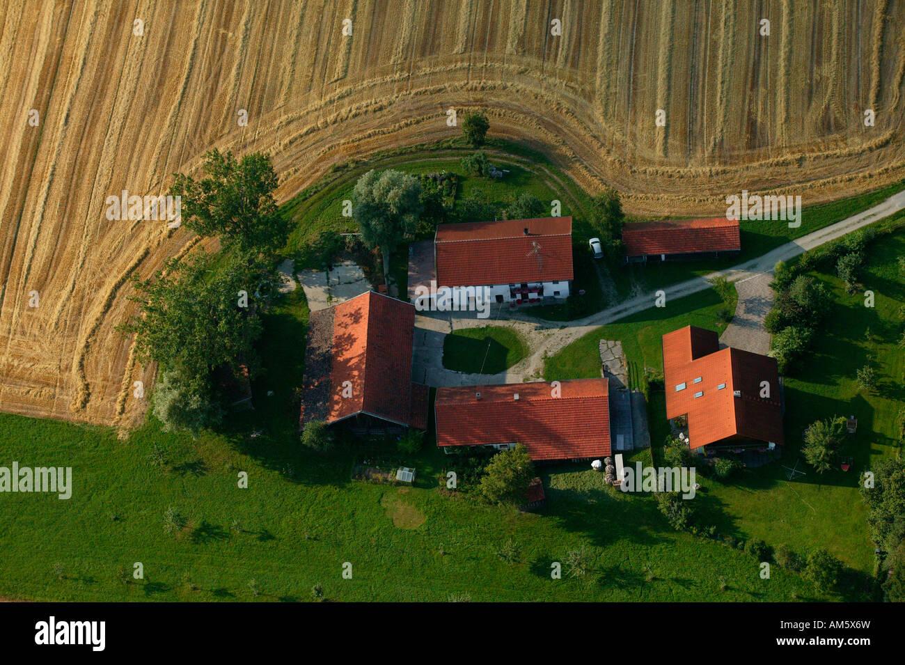 Farm between harvested grainfields, Lower Bavaria, Bavaria, Germany Stock Photo