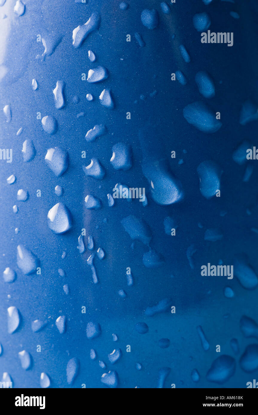 High angle view of water droplets on a blue surface - Stock Image