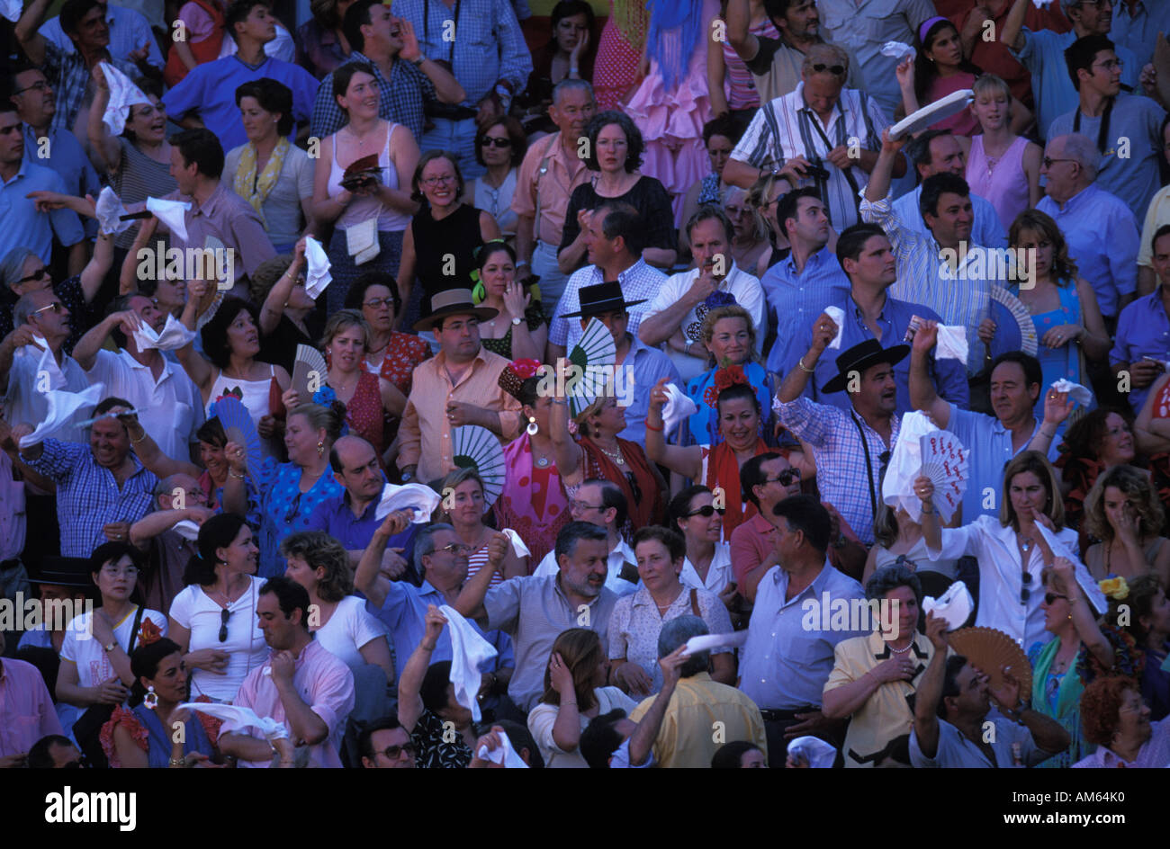 Audience in traditional clothing watching a bullfight - Stock Image
