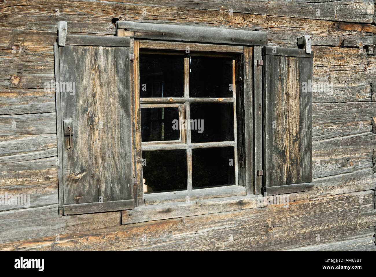 Window of timber farmhouse originally located in south Tyrol, reconstructed at the farmhous museum Breitenbach Austria - Stock Image