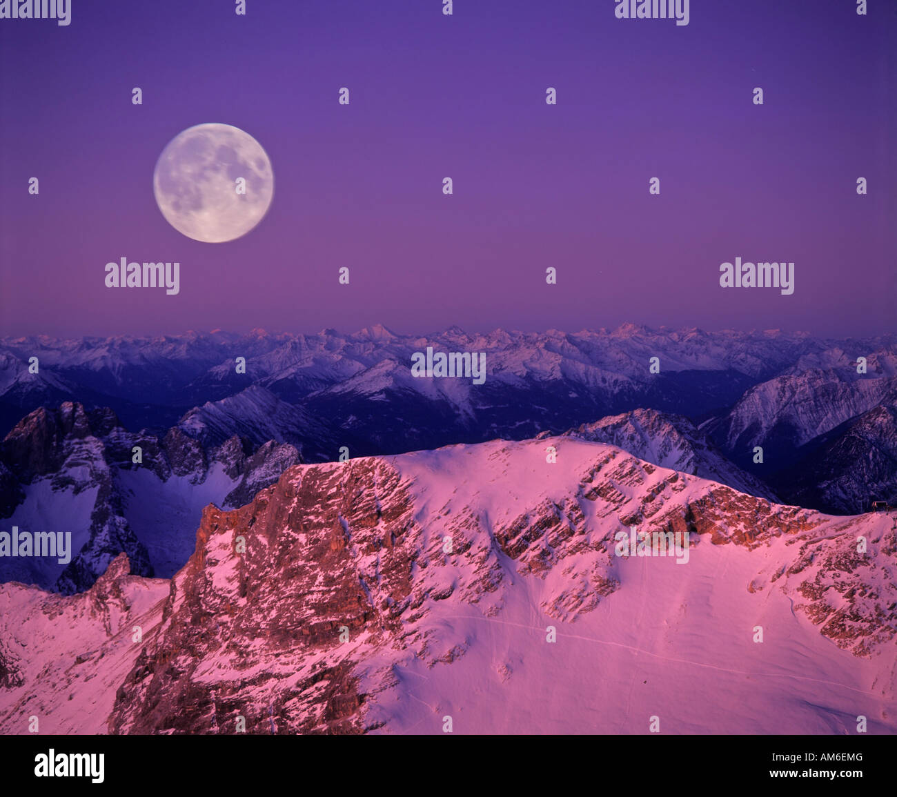 View from Zugspitze, full moon over the Lechtal Alps, dawn, Wettersteingebirge, Tyrol, Austria - Stock Image