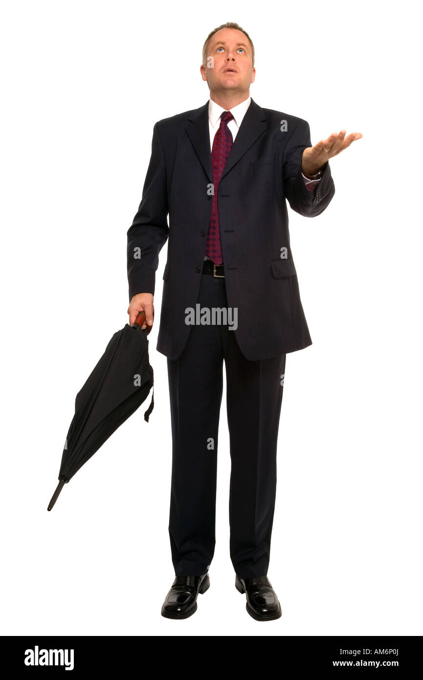 Businessman with an umbrella making a calculated guess whether it going to rain is it worth the risk - Stock Image
