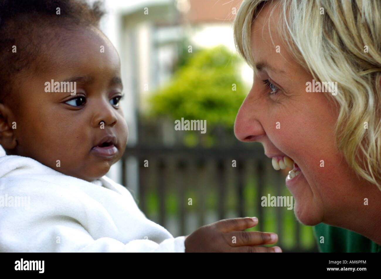 A woman has fun with a baby - Stock Image