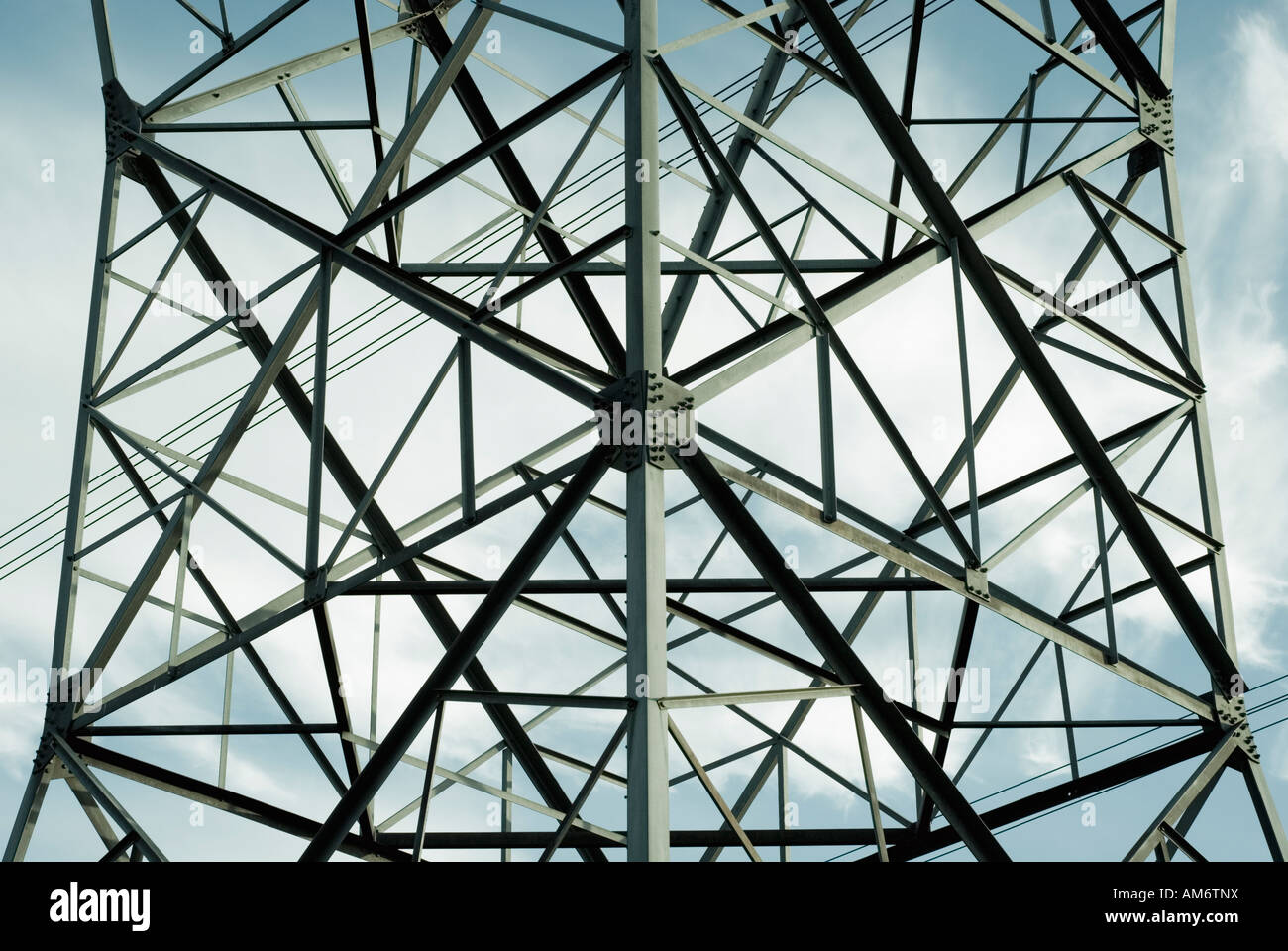 Detail of High graphicVoltage Electricity Transmission Tower - Stock Image