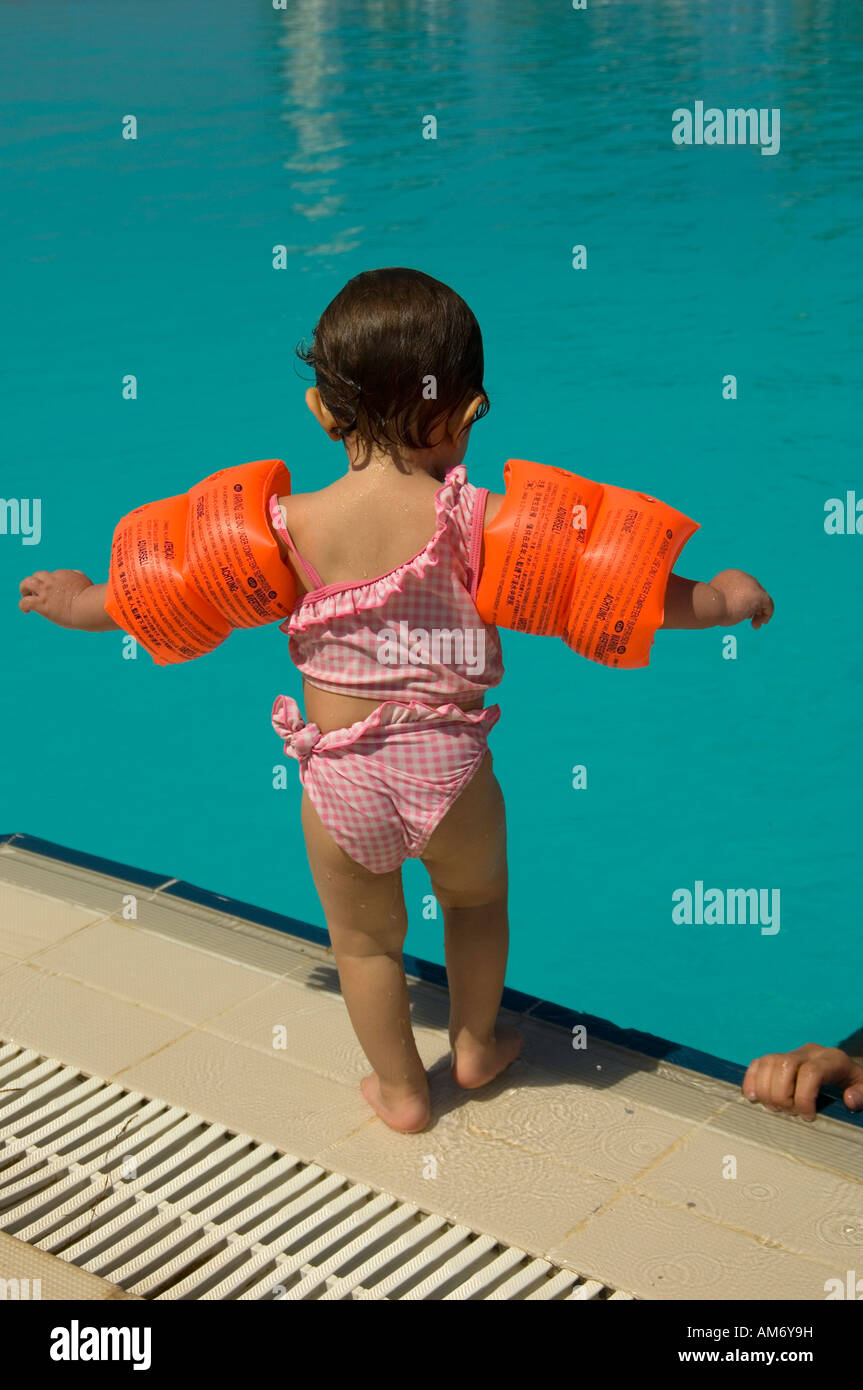 30cf675883a baby girl getting ready to jump in swimming pool Stock Photo ...