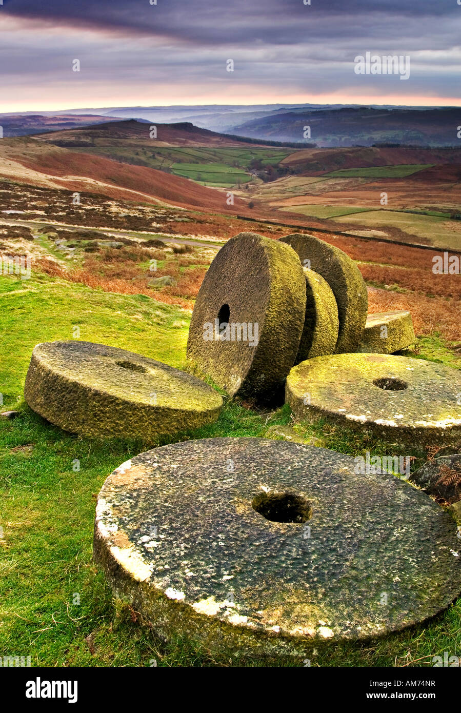 Abandoned Millstones Below Stanage Edge at Sunrise, Near Hathersage, Peak District National Park, Derbyshire, England, Stock Photo