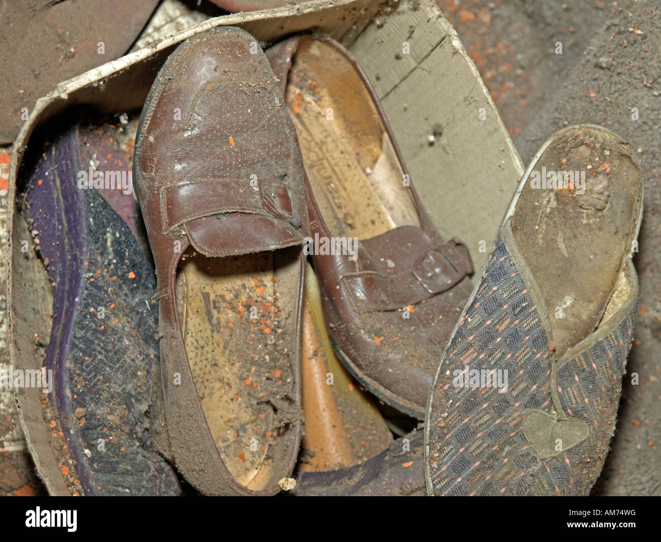 old dirty shoes and slippers - Stock Image