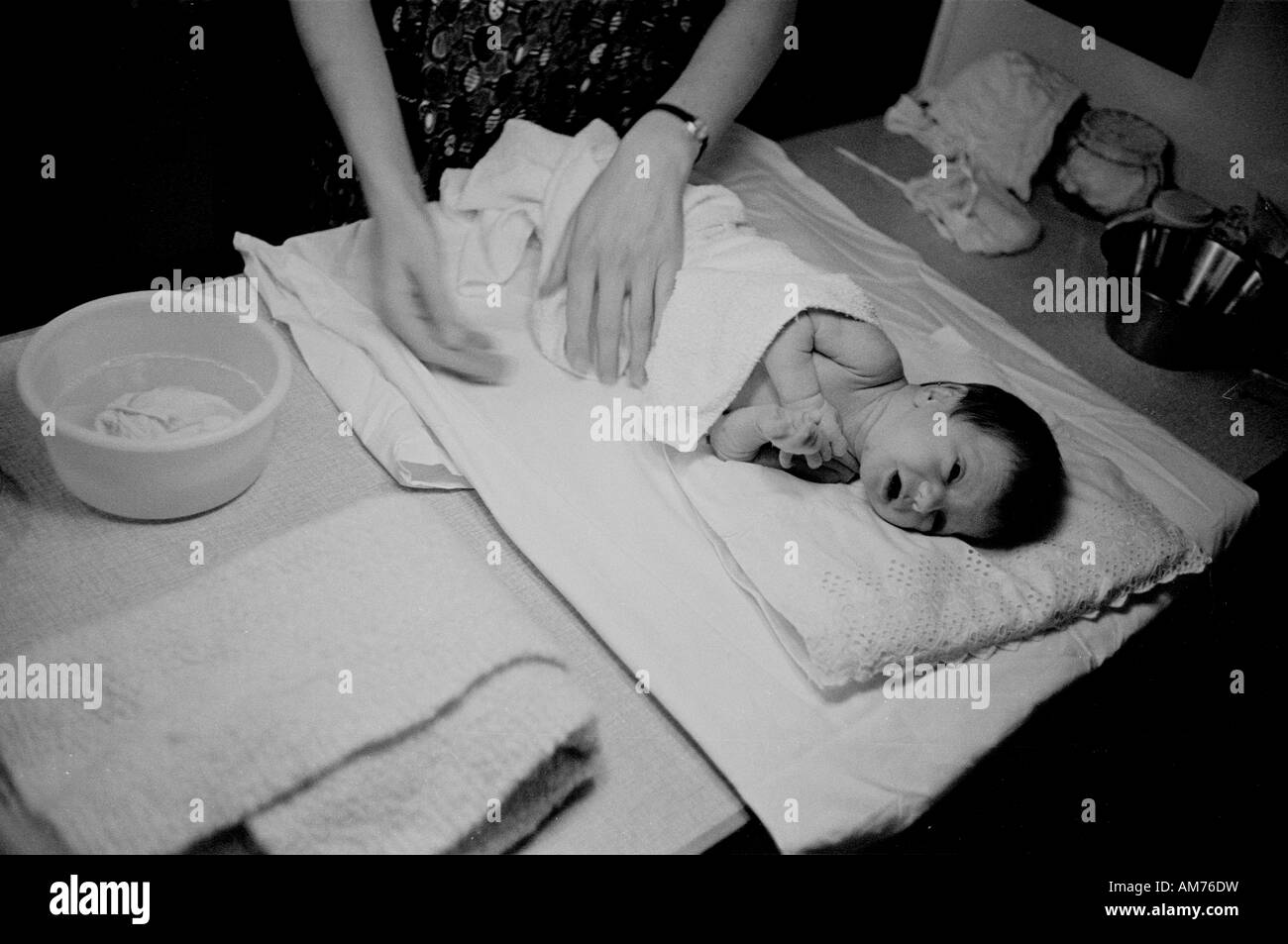Tending an infant in the sixties - Stock Image