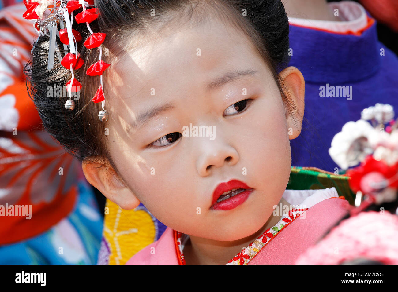 Little Japanese girl with made-up mouth, Japan fair, Duesseldorf, NRW, Germany - Stock Image