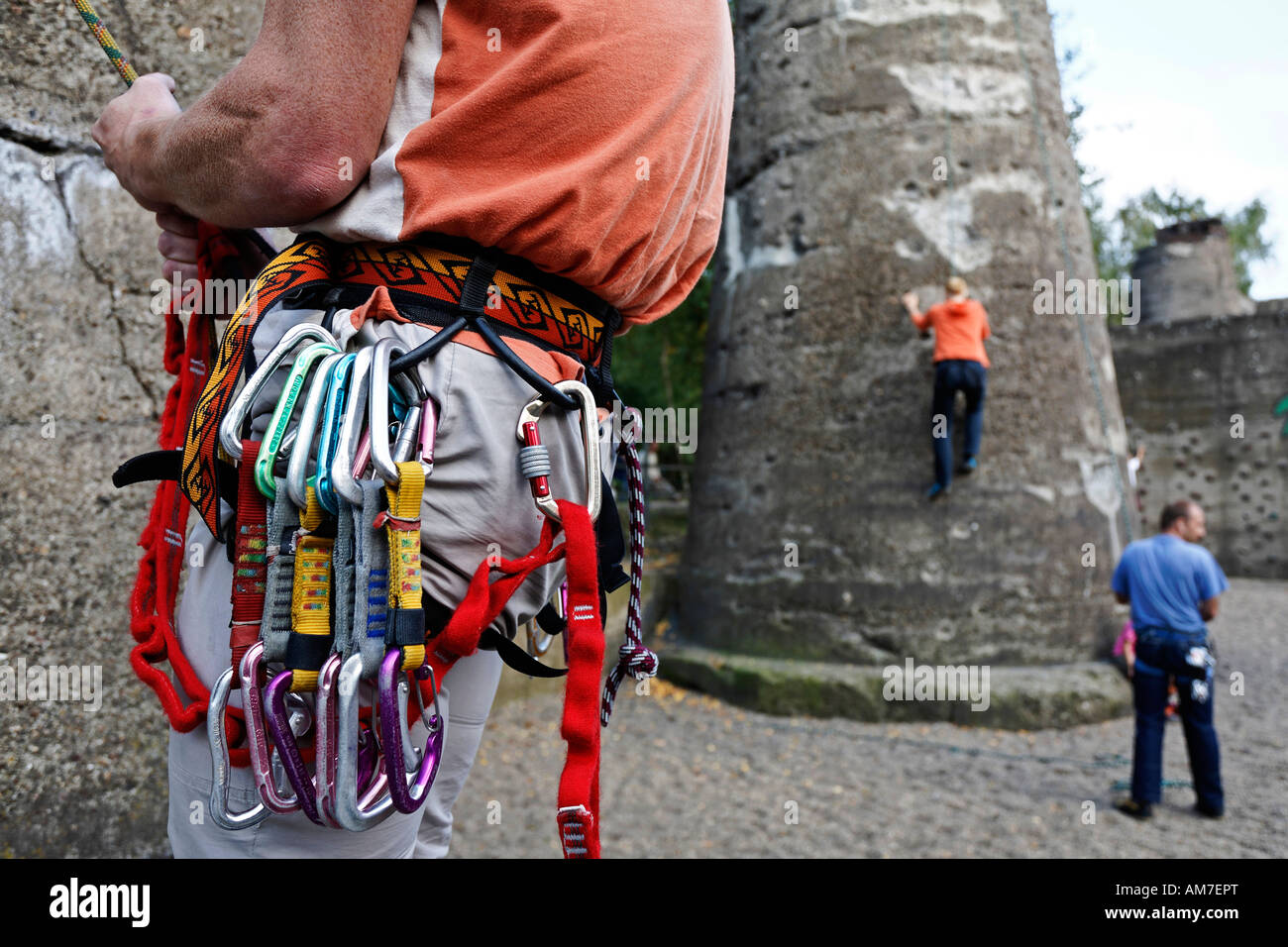 Mountaineer with colourful carbine belt, climbing garden of the former steelworks of Thyssen at Meiderich, landscape - Stock Image
