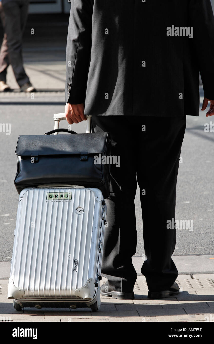 Business traveller pulling a trolley, airport Duesseldorf, NRW, Germany - Stock Image