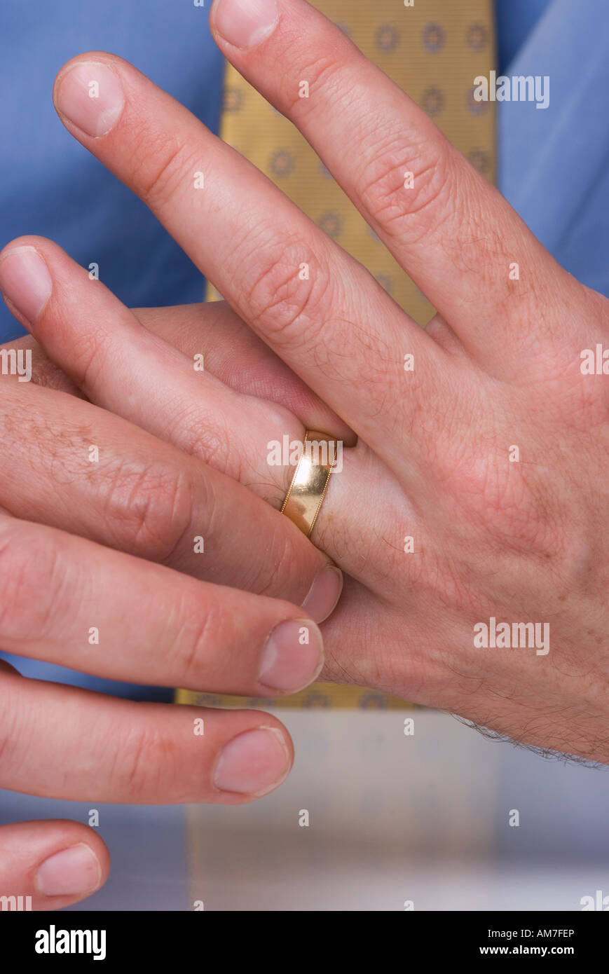 Close up of man\'s hands with wedding ring on finger. Man touching ...