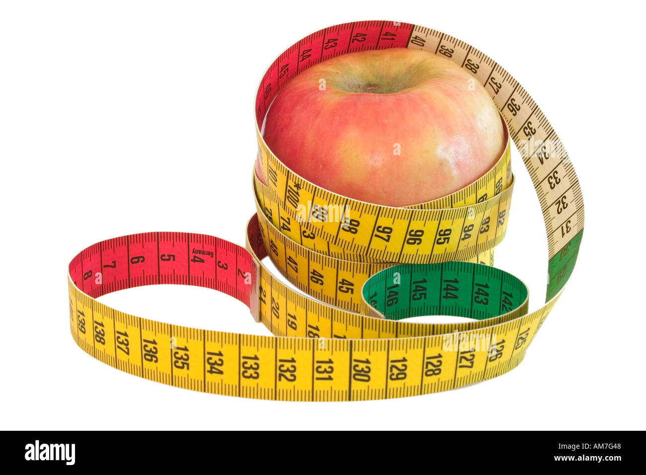 A tape measure wrapped around an apple isolated on a white background - Stock Image