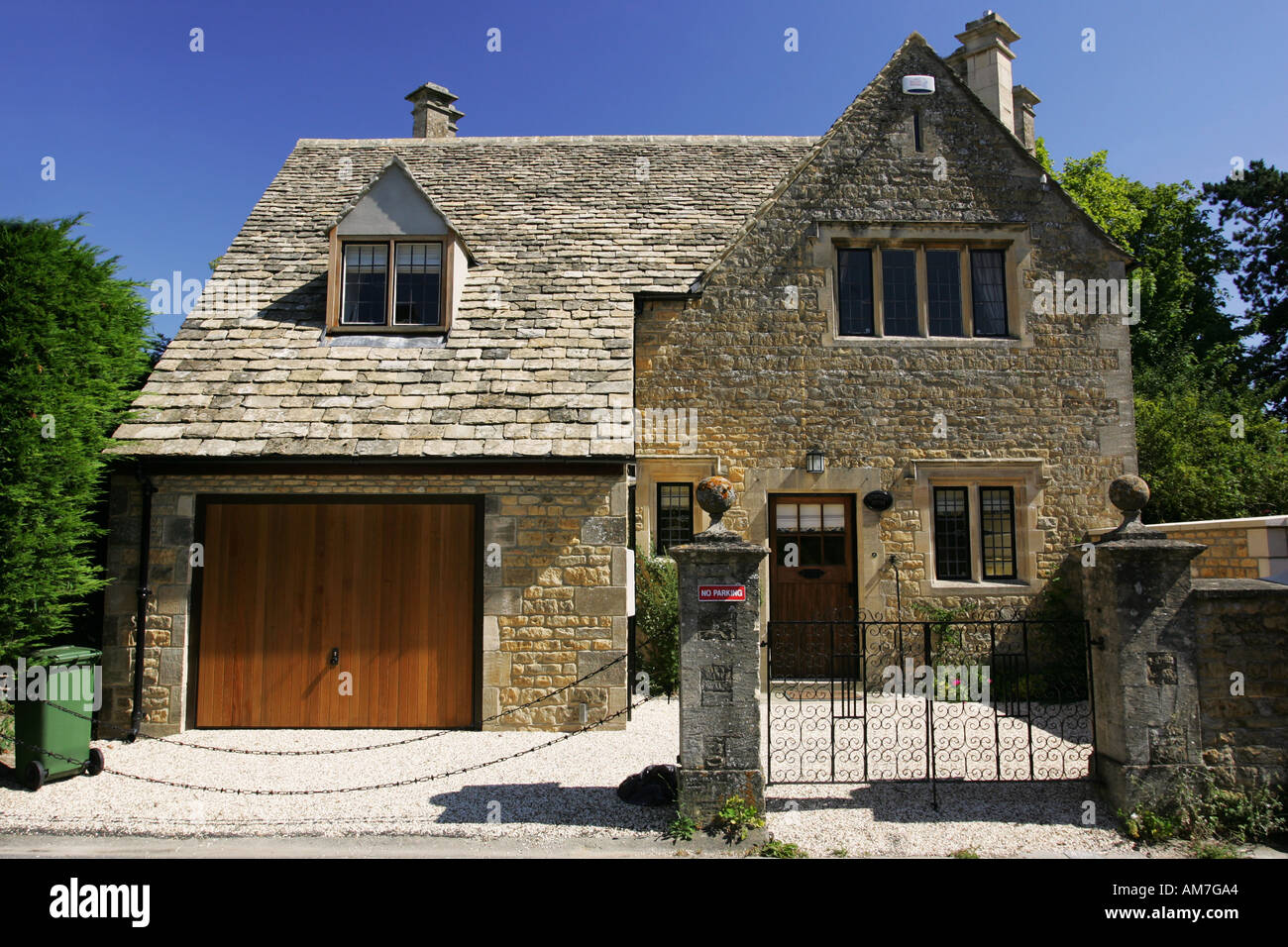 New typical cotswold limestone town house in popular English tourist destination Bourton on the Water Gloucestershire Stock Photo