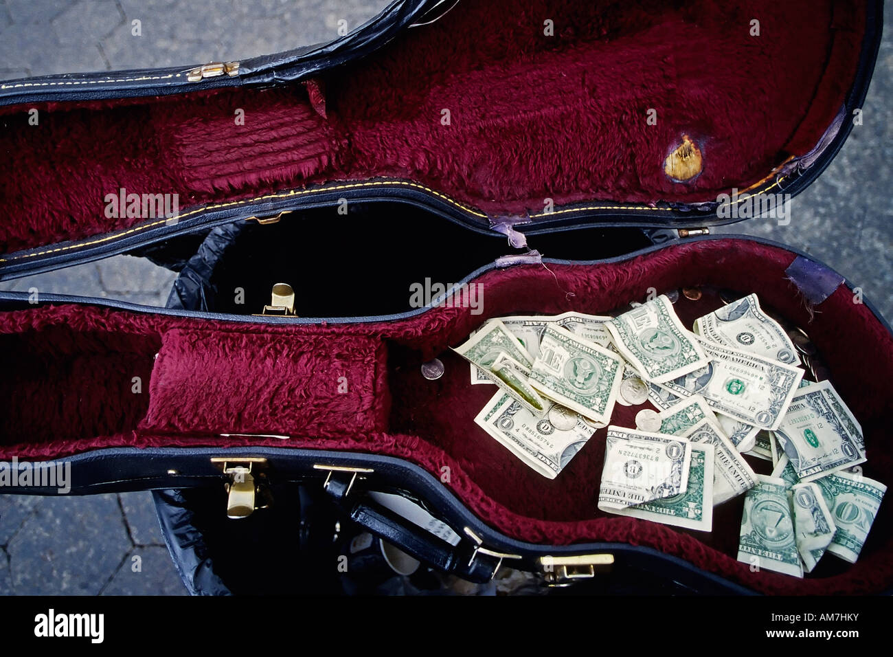 Dollar notes collected in a violine case of a street musican, New York City, USA - Stock Image